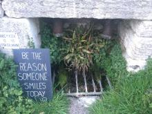 Sign on a spring in Minchinhampton